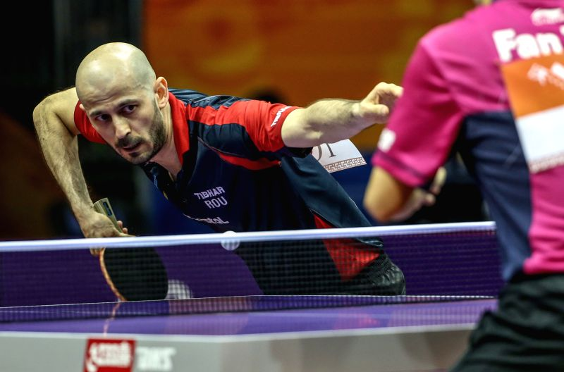 Romania's Constantin Cioti acts against China's Fan Zhendong during Men's Singles match at the 53rd Table Tennis World Championships in Suzhou, city of east China's ...