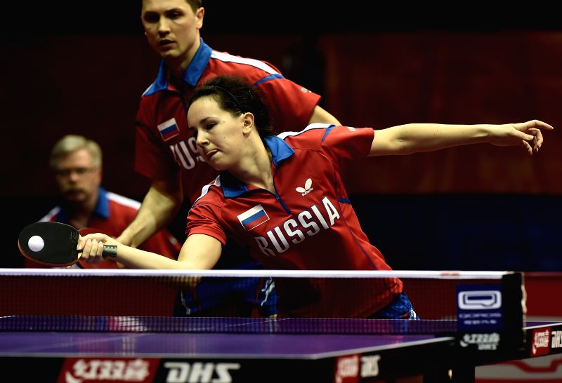 Russia's Alexey Liventsov(Rear)/Yulia Prokhorova compete during the Mixed Doubles match against Croatia's Tomislav Kolarek/Tian Yuan at the 53rd Table Tennis World ...