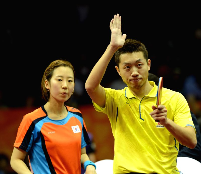 China's Xu Xin(R)/South Korea's Yang Haeun wave to the crowd after winning the Mixed Doubles match against Germany's Steffen Mengel/Petrissa Solja at the 53rd Table ...