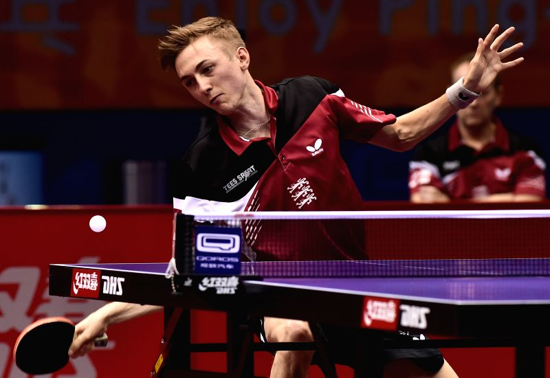 England's Liam Pitchford competes against Portugal's Tiago Apolonia during the Men's Singles match at the 53rd Table Tennis World Championships in Suzhou, city of ...