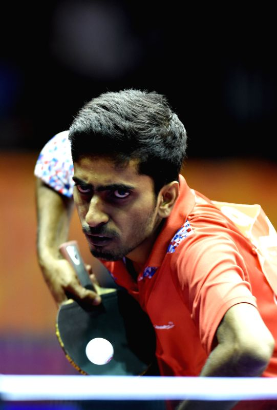 India's Sathiyan Gnanasekaran competes against China's Fang Bo during Men's Singles match at the 53rd Table Tennis World Championships in Suzhou, city of east ...