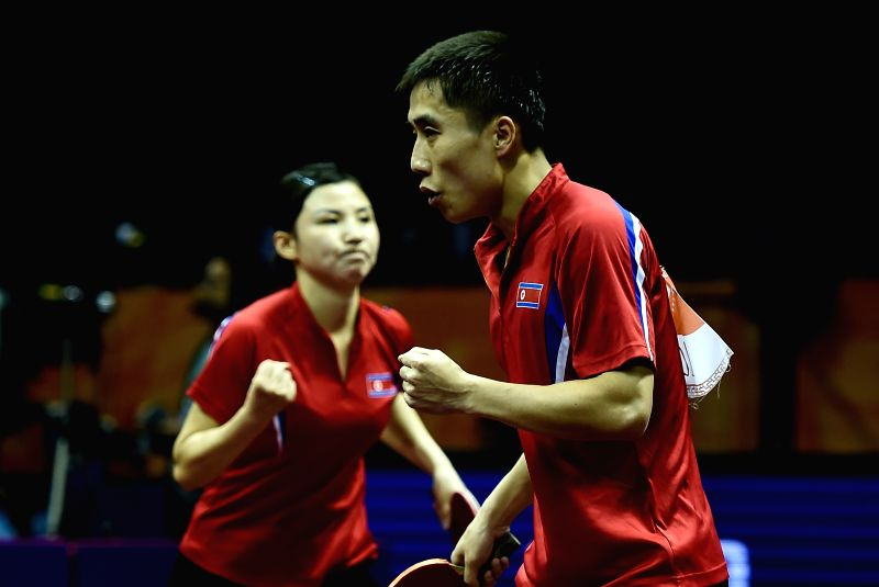 Kim Hyok Bong(R)/Kim Jong of the Democratic People's Republic of Korea (DPRK) celebrate the score during Mixed Doubles match against China's Yan An/Wu Yang at the ...