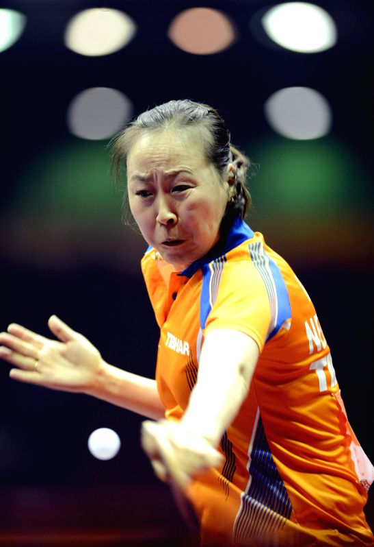 The Netherland's Li Jiao competes against France's Xian Yifang during Women's Singles match at the 53rd Table Tennis World Championships in Suzhou, city of east ...