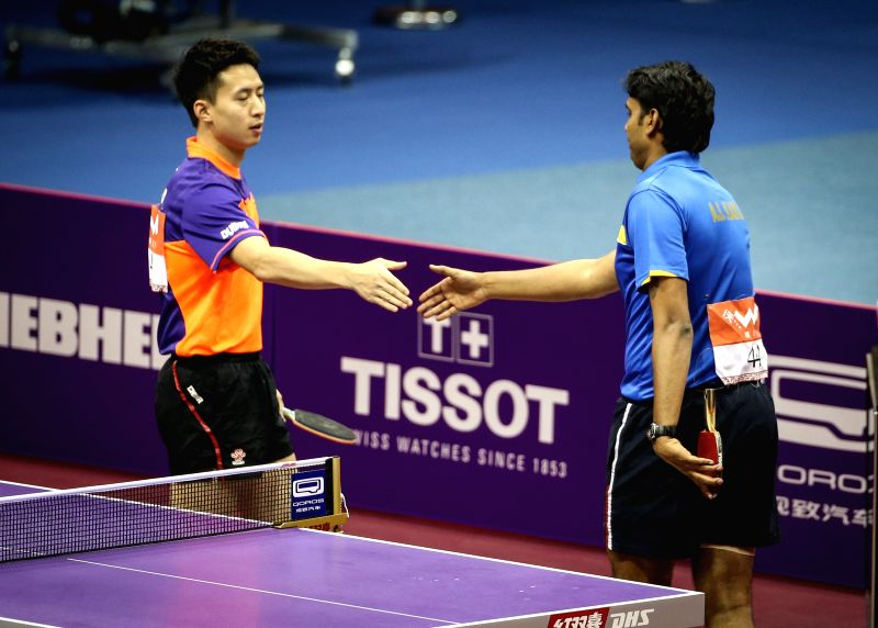 India's Sharath Kamal Achanta(R) shakes hands with China's Fang Bo after their Men's Singles match at the 53rd Table Tennis World Championships in Suzhou, city of ...