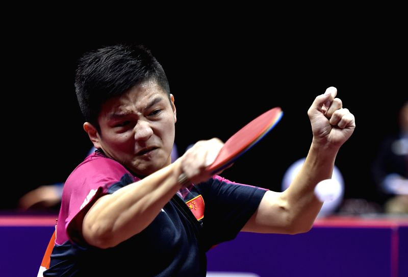 China's Fan Zhendong competes against Japan's Niwa Koki during Men's Singles match at the 53rd Table Tennis World Championships in Suzhou, city of east China's Jiangsu ...