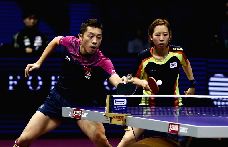 China's Xu Xin(L)/South Korea's Yang Haeun compete during the Mixed Doubles Final match against Japan's Yoshimura Maharu/Ishikawa Kasumi at the 53rd Table Tennis World ...