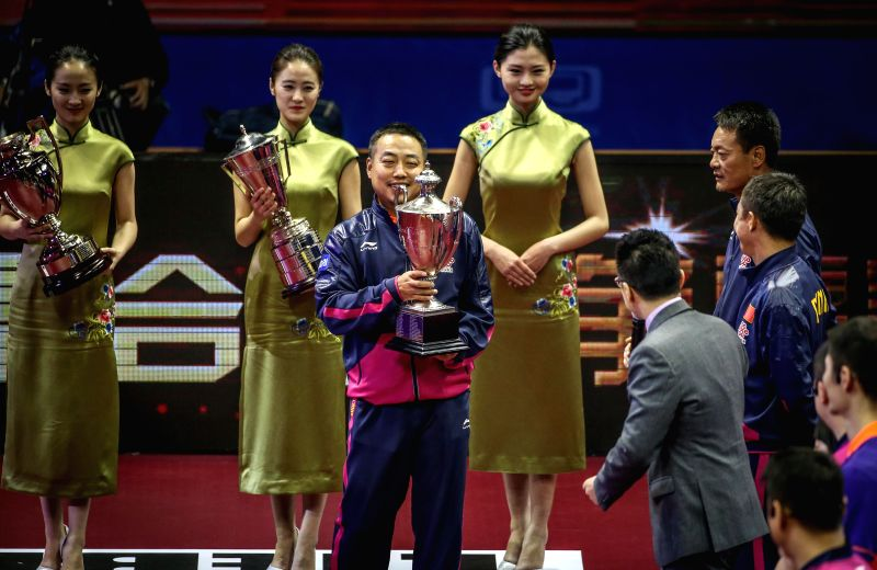 Famous Chinese table tennis player Liu Guoliang(C) attends a promotional match at the 53rd Table Tennis World Championships in Suzhou, city of east China's Jiangsu ...