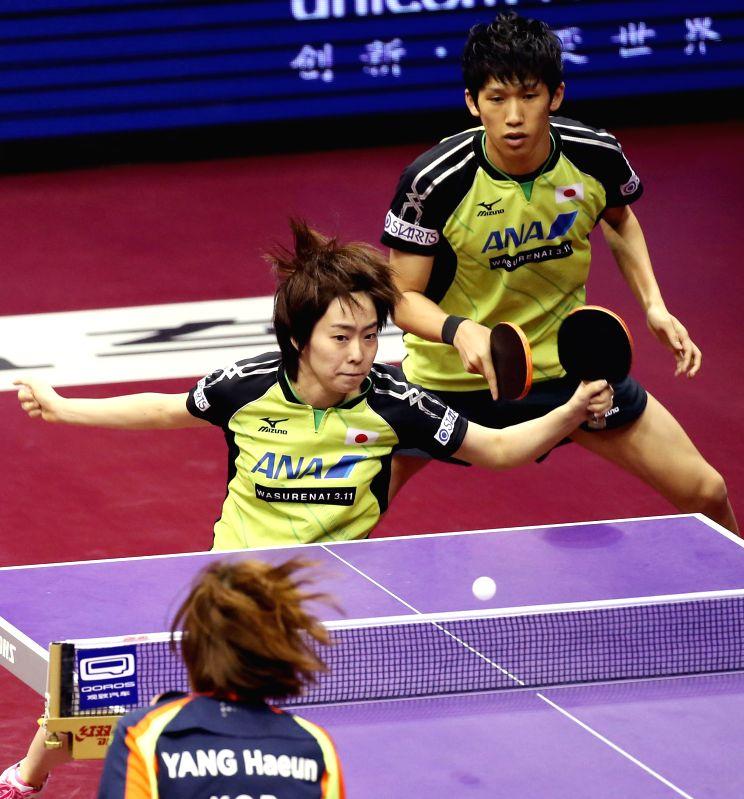 Japan's Yoshimura Maharu/Ishikawa Kasumi(L) compete during the Mixed Doubles Final match against China's Xu Xin/South Korea's Yang Haeun at the 53rd Table Tennis World ...