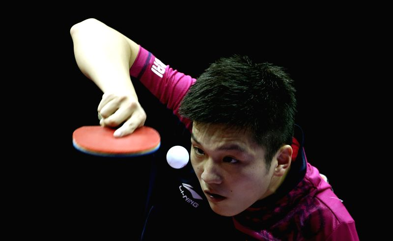 China's Fan Zhendong competes against Germany's Timo Boll during Men's Singles Quarterfinal at the 53rd Table Tennis World Championships in Suzhou, city of east ...