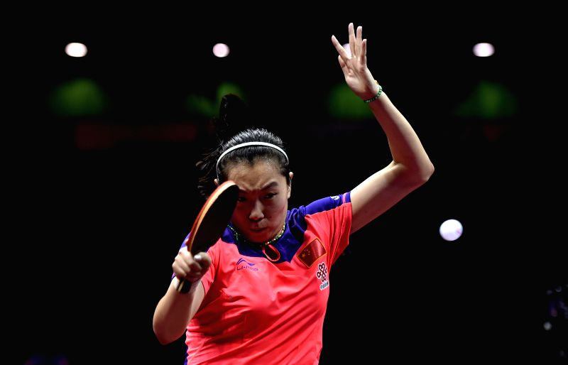China's Li Xiaoxia competes against her compatriot Liu Shiwen during the women's singles semifinal at the 53rd Table Tennis World Championships in Suzhou, city of east ...