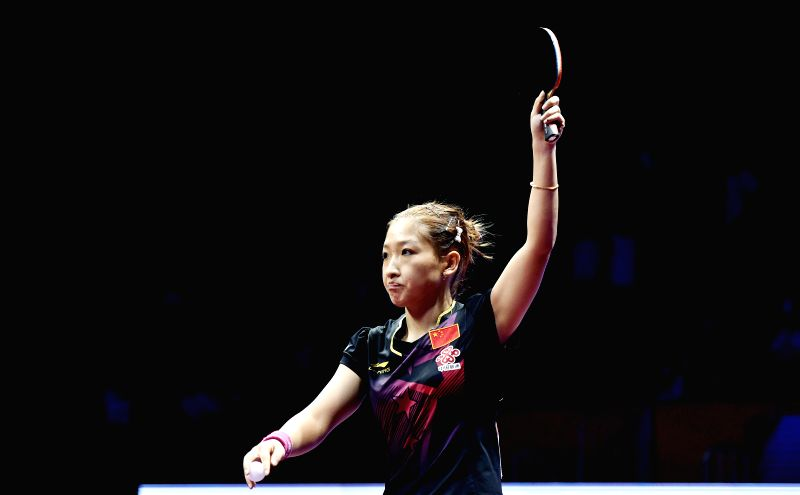 China's Liu Shiwen greets the audience after the women's singles semifinal against her compatriot Li Xiaoxai at the 53rd Table Tennis World Championships in Suzhou, ...
