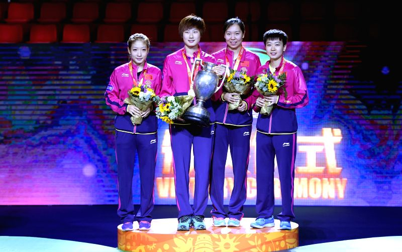 China's Liu Shiwen, Ding Ning, Li Xiaoxia & Mu Zi(From L to R) pose on the podium during the awarding ceremony for the Women's Singles Final match at the 53rd ...