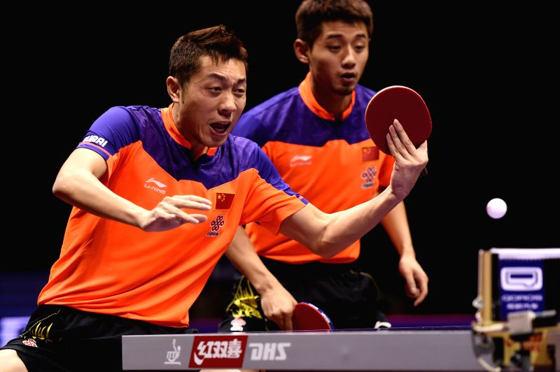 China's Xu Xin(L)/Zhang Jike compete during the Men's Doubles Semifinal match against South Korea's Lee Sangsu/Seo Hyundeok at the 53rd Table Tennis World ...