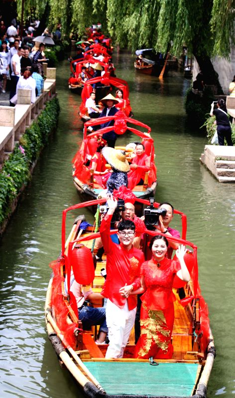 SUZHOU, May 20, 2017 - Newlyweds take boat at their wedding ceremony in Zhouzhuang ancient town of Suzhou City, east China's Jiangsu Province, May 20, 2017. Many couples in China chose to register ...