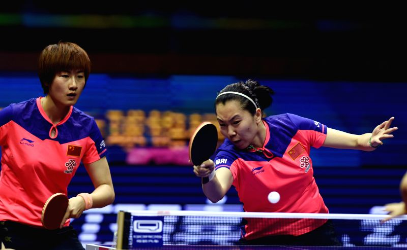 China's Ding Ning/Li Xiaoxia(R) compete against their compatriots Zhu Yuling/Liu Shiwen during Women's Doubles Final at the 53rd Table Tennis World Championships in ...