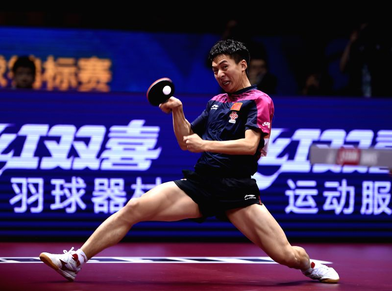 China's Fang Bo competes during Men's Singles Semifinal against his compatriot Zhang Jike at the 53rd Table Tennis World Championships in Suzhou, city of east China's ...