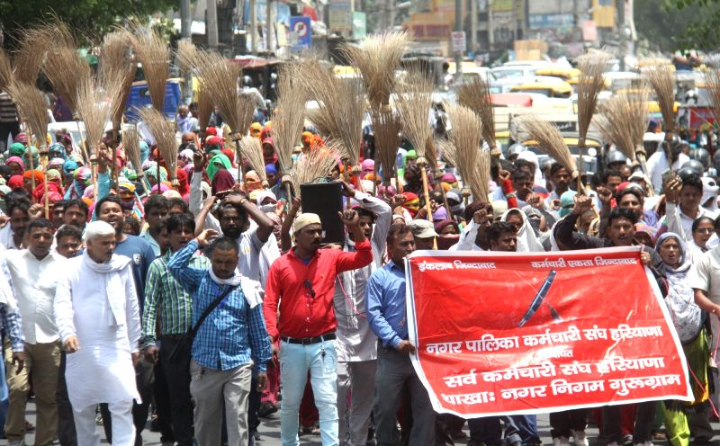 Sweepers of Municipal Corporation of Gurugram (MCG) stage a demonstration to press for their demands in Gurugram on June 7, 2017.