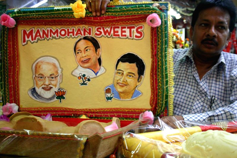 Sweet sellers use pictures of political leaders on the packets used to pack sweets in Kolkata ahead of 2014 Lok Sabha Polls; on April 24, 2014.
