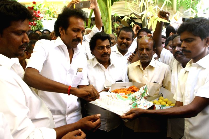 Sweets being distributed during DMK chief Karunanidhi's birthday celebrations in Chennai on June 3, 2017.