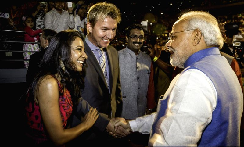 Actress Tannishtha Chatterjee and Australian cricketer Brett Lee interact with Prime Minister Narendra Modi at Sydney All Phones Arena, Australia. - Narendra Modi