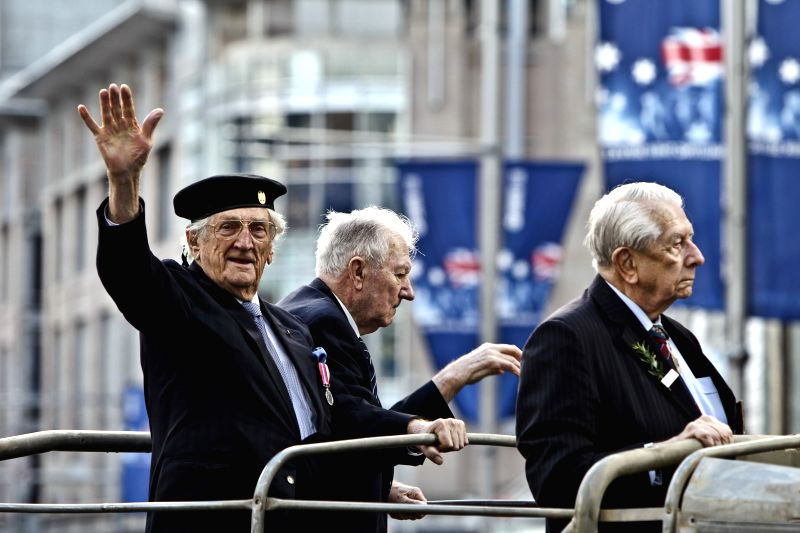 Veterans attend the march commemorating the ANZAC Day centenary in Sydney, Australia, April 25, 2015. Hundreds of thousands of Australians across the country ...