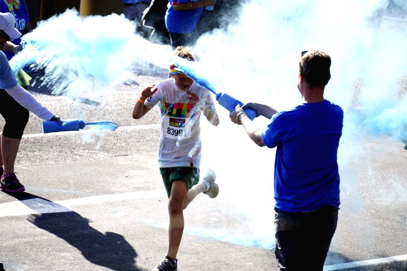 People attend the happy Color Run in Sydney, Australia, on Aug. 24, 2014. The Color Run events will happen consecutively in Adelaide, Townsville, Sunshine Coast, ...