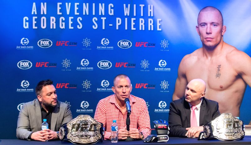 SYDNEY, Aug. 6, 2018 - Ultimate Fighting Championship(UFC) player George St-Pierre (C) attends a press conference in Sydney, Australia, on Aug. 6, 2018. St-Pierre will give three speeches in Sydney, ...