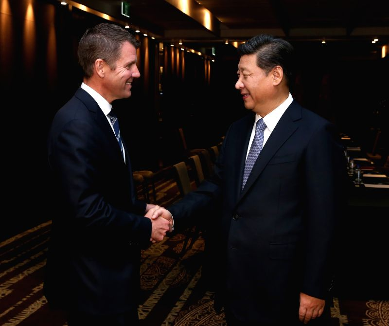 Sydney (Australia): Chinese President Xi Jinping (R) meets with New South Wales Premier Mike Baird in Sydney, Australia, Nov. 19, 2014.