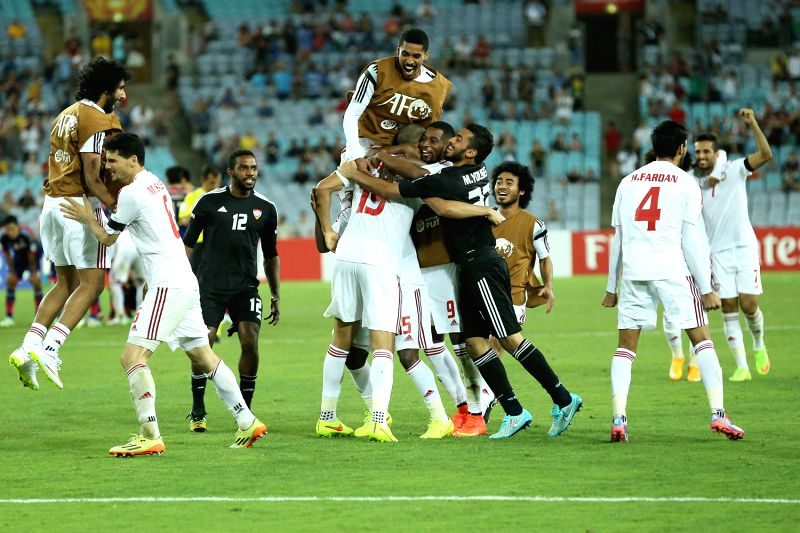 Players of United Arab Emirates celebrate their victory against Japan after the quarterfinal match at the 2015 AFC Asian Cup in Sydney, Australia, Jan. 23, 2015. ...