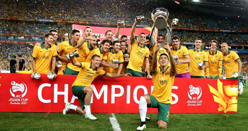 Australian players celebrate with the Asian Cup trophy after winning the final against South Korea at the 2015 AFC Asian Cup in Sydney, Australia, Jan. 31, 2015. ...
