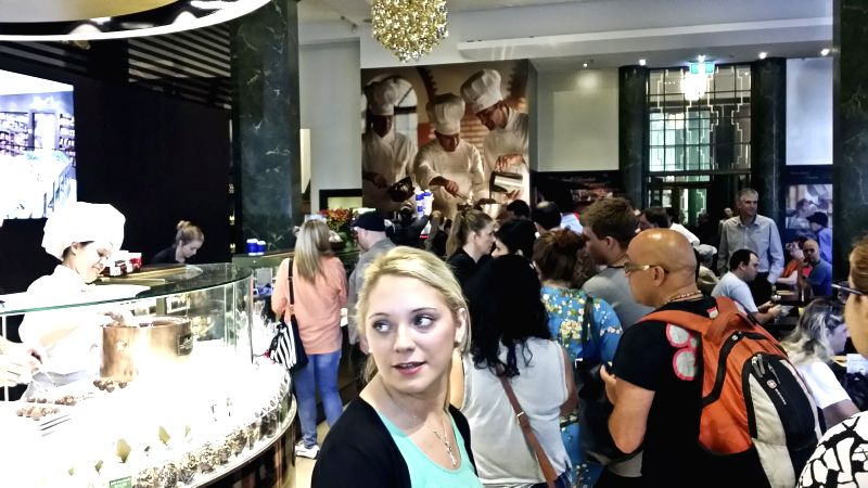 Customers enter the Lindt Chocolate cafe, where the Sydney cafe siege happened on Dec. 15, 2014, in Sydney, Australia, March 20, 2015. The cafe was reopened on ...
