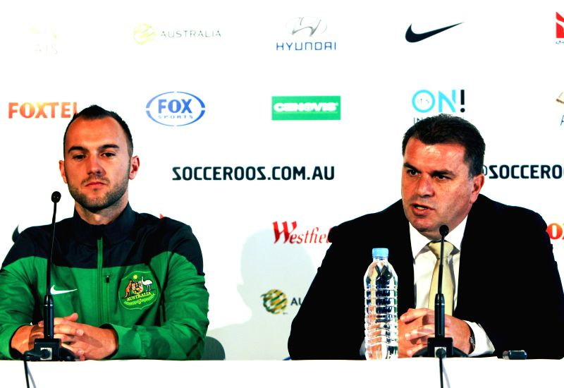 Australian national soccer team coach Ange Postecoglou (R) attends a press conference announcing the list of the 30 players for the upcoming FIFA World Cup Brazil ...