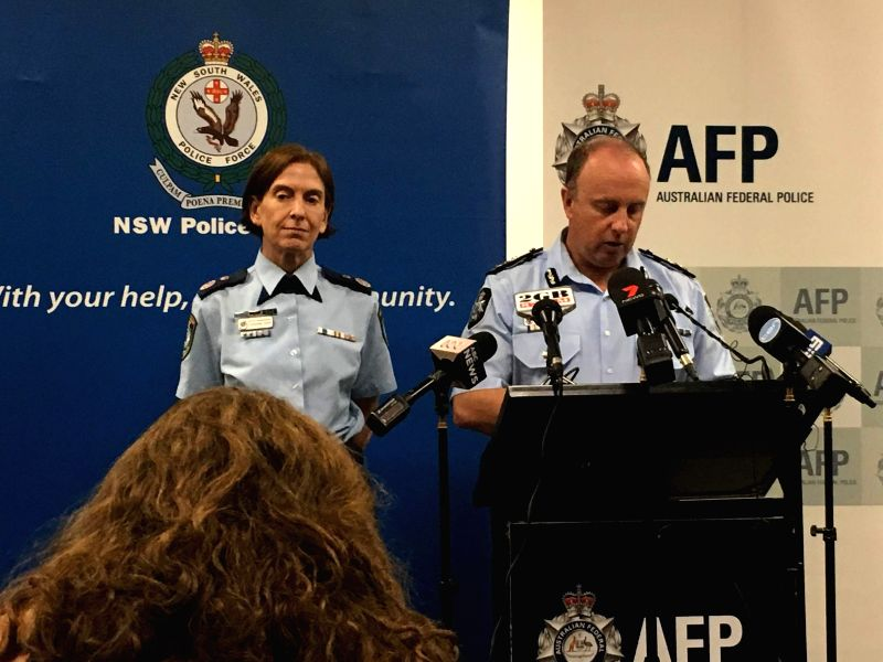 SYDNEY, May 17, 2016 - Acting deputy commissioner of Australian Federal Police Neil Gaughan (R) delivers a speech in Sydney, Australia, May 17, 2016. An Australian teenager who was stopped from ...