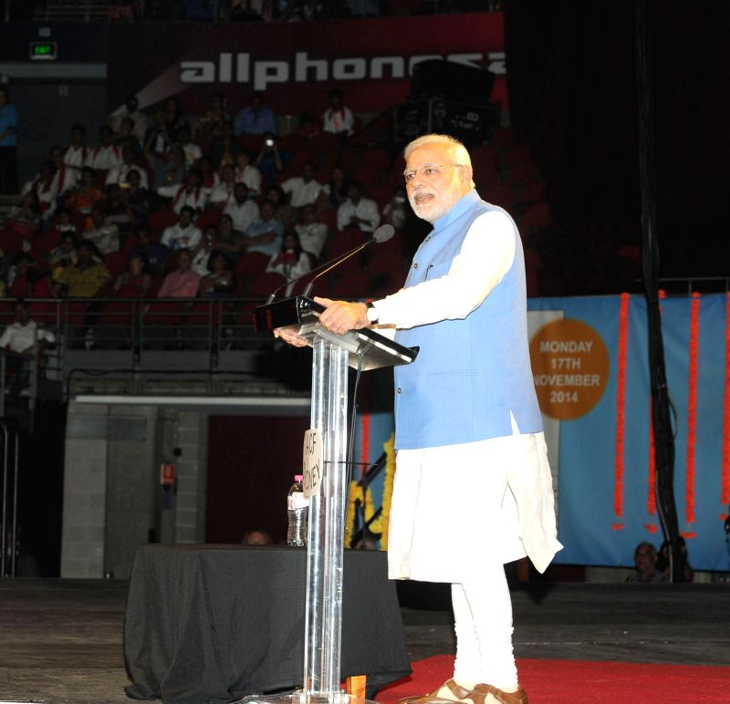 Prime Minister, Narendra Modi addresses a gathering at the Community Reception, held at Allphones Arena, in Sydney, Australia on Nov 17, 2014. - Narendra Modi