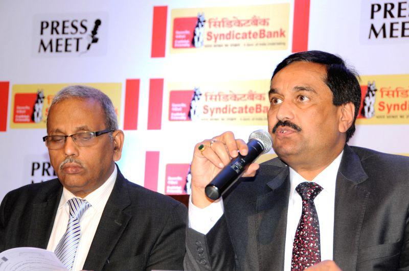 Syndicate Bank CMD Sudhir Kumar Jain and banks's Executive Director M Anjaneya Prasad during a press conference in Bangalore on May 7, 2014. - Sudhir Kumar Jain