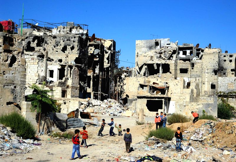 Syrian boys play in the war-ravaged town of Dukhaniyeh, east of Damascus, capital of Syria, on Nov. 14, 2015. Dukhaniyeh has witnessed intense battles between the ...
