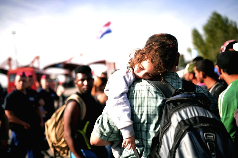 :Syrian refugess are moved from camp Beli Manastir in Croatia to the border in Baranjask to be picked up by Hungarian buses that will leave them five kilometers from this border, 18 September 2015. ...