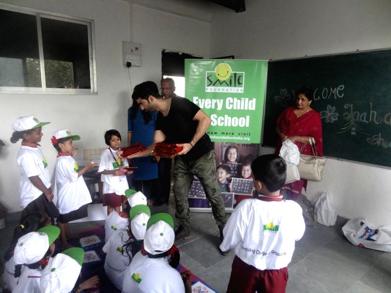 Taaha Shah encourages child education
