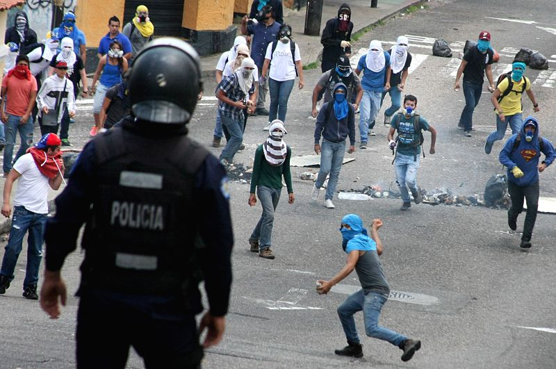 Demonstrators clash with members of the Public Order Brigade of the National Bolivarian Police during an anti-government protest in front of Catholic University of ...
