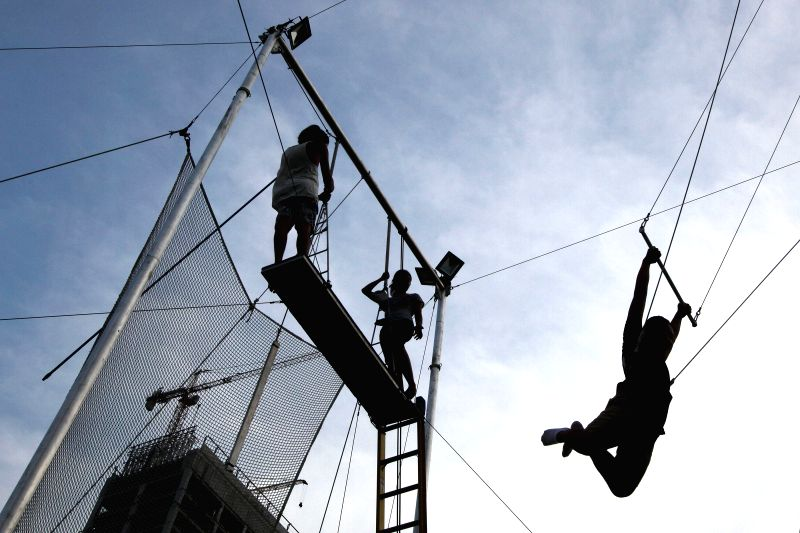 A flying trapeze student swings in the Flying Trapeze Philippines School, Taguig City, the Philippines, on Aug. 15, 2014. The Flying Trapeze Philippines (FTP) ..