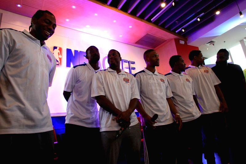 NBA basketball players pose for a photo during the Charity Event press conference in Taguig City, the Philippines, July 21, 2014. A total of 12 NBA players will