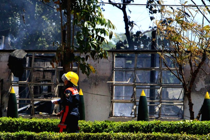 A firefighter is seen after a powerful explosion that rocked the Philippine Army's Explosives and Ordnance Division (EOD) building inside Fort Bonifacio in Taguig