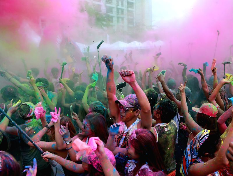 TAGUIG CITY  (PHILIPPINES), July 30, 2017 Runners throw various colored powder in the air during the 2017 Color Manila Challenge Fun Run in Taguig City, the Philippines, July 30, 2017. ...