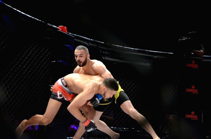 Tahar Hadbi of France and Carl Booth of England in action during a Mixed Martial Arts match in Mumbai on April 23, 2017.