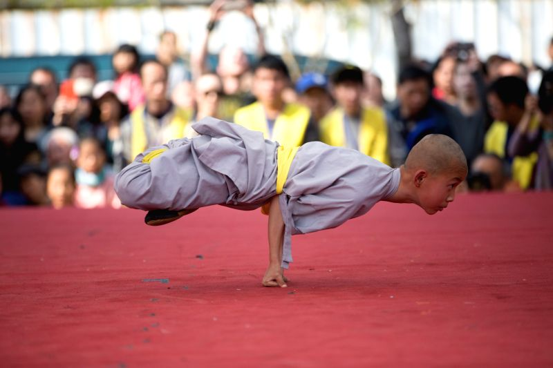Visitors watch martial art performance during a temple fair at the cultural and creative industry park in Taichung, southeast China's Taiwan, Feb. 19, 2015. Folk ...