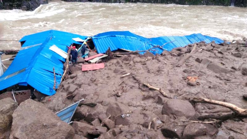TAINING, May 8, 2016 - Photo taken by a mobile phone shows the landslide site in Taining County of Sanming City, southeast China's Fujian Province, May 8, 2016. Thirty-five people got lost after a ...