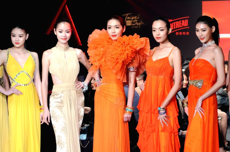 Models present creations designed by Goji Lin in Taipei, southeast China's Taiwan, April 9, 2015.