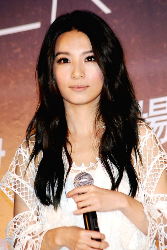 "Hebe, member of the pop group S.H.E, attends the press conference of their encore concerts of ""2GETHER 4EVER"" World Tour 2014 in Taipei, southeast China's"