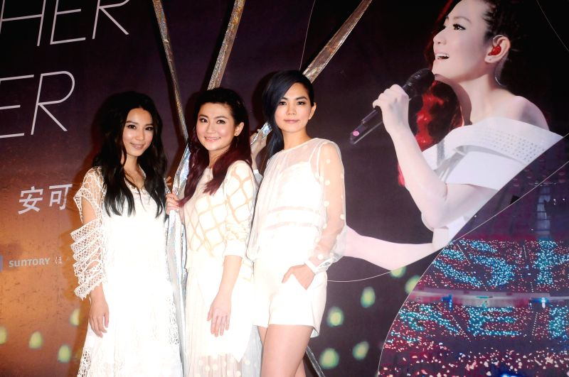 """Members of the pop group S.H.E attend the press conference of their encore concerts of """"2GETHER 4EVER"""" World Tour 2014 in Taipei, southeast China's ..."""
