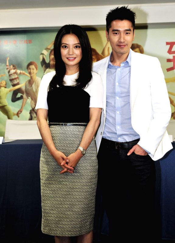 "Actress and director Zhao Wei (L) poses for photos with actor Mark Chao as they attend a press conference of ""So Young"", a romance film directed by Zhao, ."